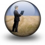 Man on laptop in field